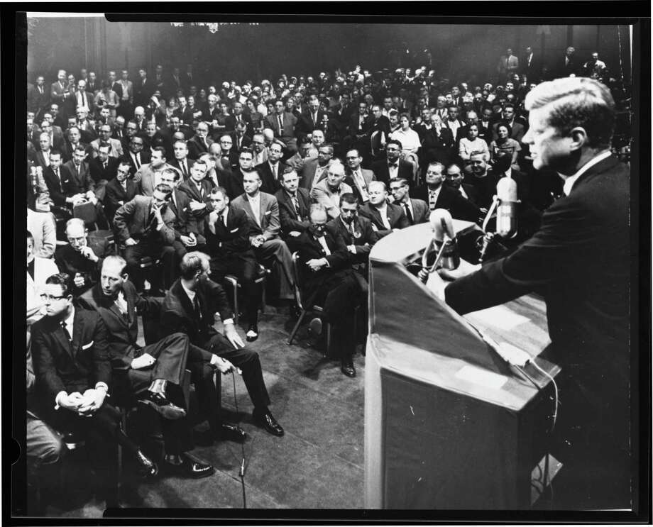 The oratory of John F. Kennedy, shown here at a question and answer session with the Minister's Association of Greater Houston in 1960, has been replaced the crass rhetoric of Michelle Wolf at the correspondents' dinner last weekend and President Trump's own words that traffic in name-calling and nativism. Photo: /AP / Houston Chronicle