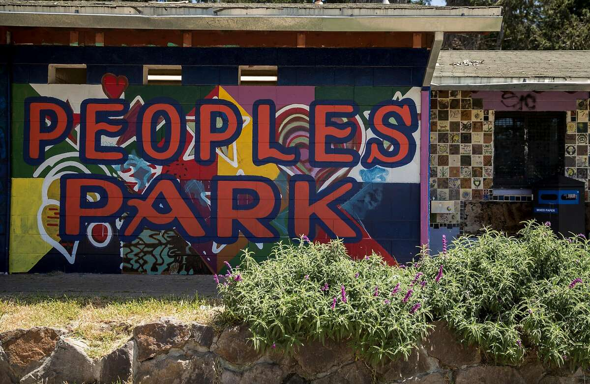 A mural for People's Park is painted on the bathroom building at People's Park in Berkeley, Calif. Tuesday, May 1, 2018.