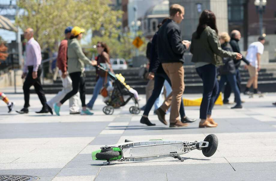 A scooter left in the plaza in front of the Ferry Building on the Embarcadero on Monday, April 30, 2018, in San Francisco, Calif. Photo: Liz Hafalia / The Chronicle