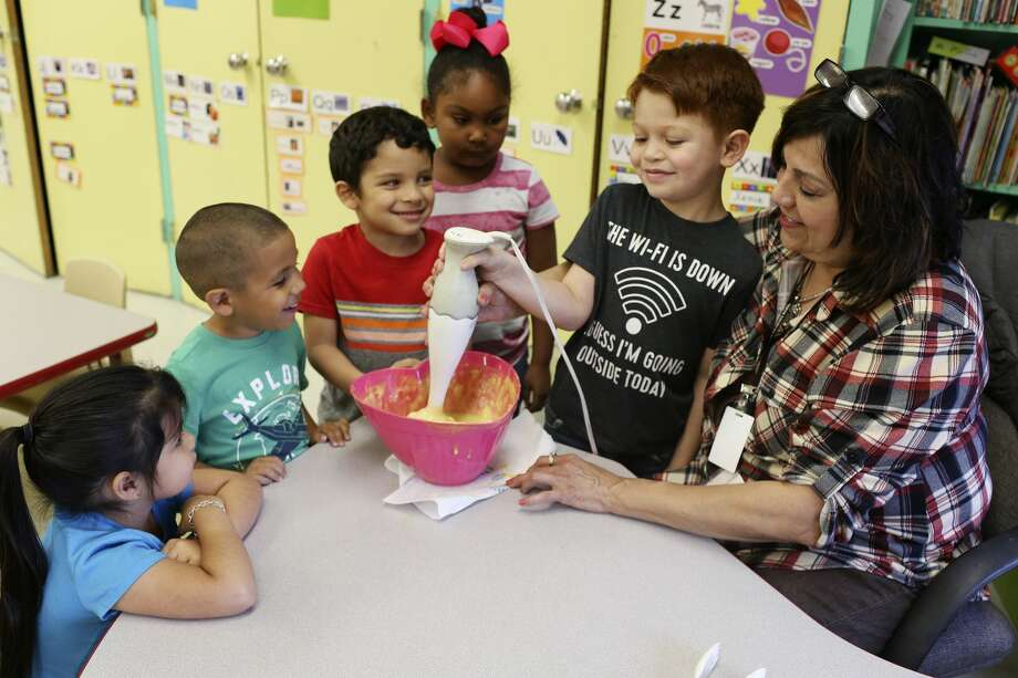 Pre-K teacher Marguerite Munoz, right, helps her students make donuts, at Kindred Elementary School in San Antonio on April 9. The students made donuts for fourth-graders to encourage them on the State of Texas Assessments of Academic Readiness (STAAR). With Munoz are from left, Savannah Trevino, 5, Jesse Flores, 4, Rylan Cruz, 5, Ronica Carter, 5, and Evan Guerrero, 5. Test-taking is a source of anxiety for many students. Photo: JERRY LARA/San Antonio Express-News