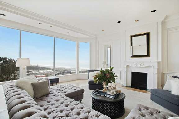 The living room at 5529 Anza St. in the Outer Richmond enjoys large picture windows framing views of the Pacific Ocean.