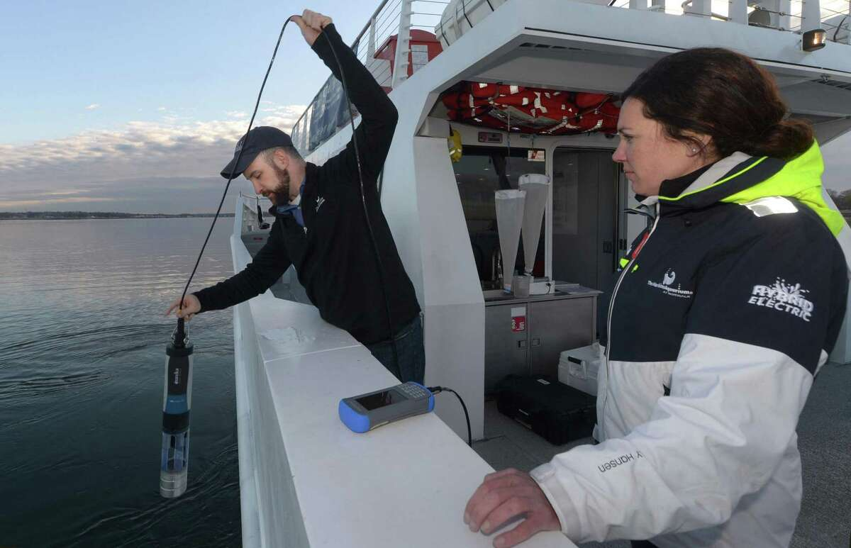Maritime Aquarium staff including Research Scientist, Dr. David Hudson, and Education Manager, Nicki Rosenfeld, use a sonde to test salt water from the Spirit of the Sound research vessel Tuesday, May 1, 2018, as The Maritime Aquarium participates in the Unified Water Study, monitoring the quality of the Norwalk Harbor in Norwalk, Conn. The first sampling of the year sampled 5 sites in the Outer Norwalk Harbor for the Study measuring temperature, salinity, turbidity (cloudiness), chlorophyll a (a measure of phytoplankton - what can cause the oxygen deprivation later in the year) and depth. The instrument is called a sonde. In addition a surface sample (a bucket full of water) was taken and filtered for chlorophyll. This project is coordinated by Save The Sound, and the science co-direction is done by Dr. Jamie Vaudrey (UConn Avery Point) and Dr. Jason Krumholz (McLaughlin Research Corporation. The study involves over 20 organizations this year, and will allow the comparison of the conditions of different harbors around the Long Island Sound.