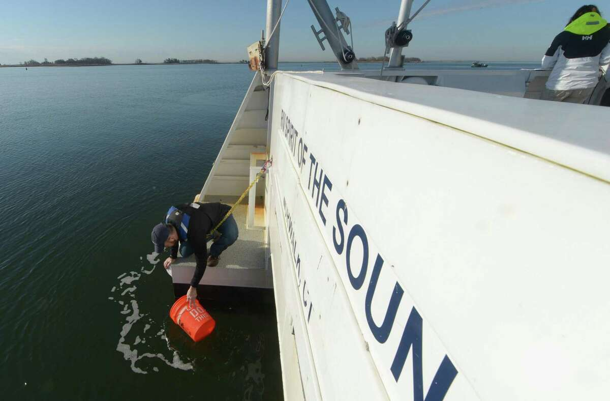 Maritime Aquarium staff including Research Scientist, Dr. David Hudson, collects a water sample from the Spirit of the Sound research vessel Tuesday, May 1, 2018, as The Maritime Aquarium participates in the Unified Water Study, monitoring the quality of the Norwalk Harbor in Norwalk, Conn. The first sampling of the year sampled 5 sites in the Outer Norwalk Harbor for the Study measuring temperature, salinity, turbidity (cloudiness), chlorophyll a (a measure of phytoplankton - what can cause the oxygen deprivation later in the year) and depth. The instrument is called a sonde. In addition a surface sample (a bucket full of water) was taken and filtered for chlorophyll. This project is coordinated by Save The Sound, and the science co-direction is done by Dr. Jamie Vaudrey (UConn Avery Point) and Dr. Jason Krumholz (McLaughlin Research Corporation. The study involves over 20 organizations this year, and will allow the comparison of the conditions of different harbors around the Long Island Sound.