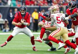 Houston Texans quarterback Tom Savage (3) is forced out of the pocket by San Francisco 49ers defensive end Cassius Marsh (54) during the first quarter of an NFL football game at NRG Stadium on Sunday, Dec. 10, 2017, in Houston. ( Brett Coomer / Houston Chronicle )