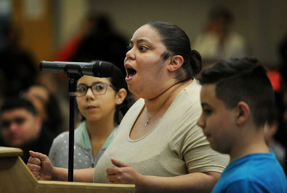 Flanked by her children Laila, 9, and Mateo, 11, Vanessa Maldonado expresses her displeasure with proposed budget cuts at a public hearing before the Bridgeport Board of Education at Geraldine Johnson School in Bridgeport, Conn. on Monday, April 30, 2018. Photo: Brian A. Pounds / Hearst Connecticut Media / Connecticut Post