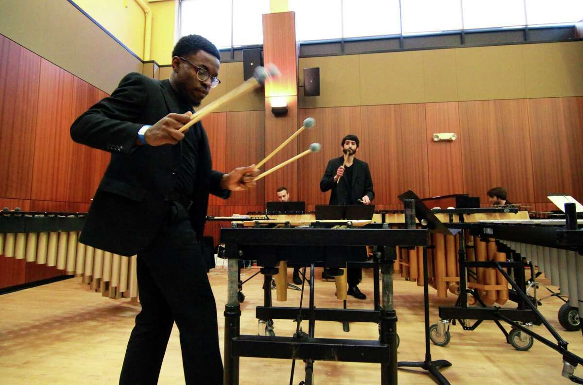 Western Connecticut State University's Elisee Ngbo performs with the school's Chamber Percussion Group during the 2018 Day of Percussion held at Sacred Heart University in Fairfield, Conn., on Saturday Apr. 28, 2018. The event, organized by the Percussive Arts Society Connecticut Chapter, featured performances by schools like Trumbull High School, Westport Middle School and University of New Haven as well as drumming and percussion clinics.