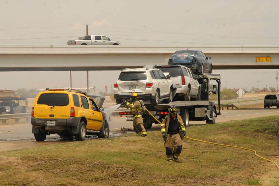 A towed vehicle caught fire about 1:40 p.m. Monday south of Exit 50 along Interstate 27 in Plainview. The Plainview Fire Department responded to the fire which was on the northbound lanes of I-27 adjacent to Northwest Church of Christ, 2000 N. I-27. The blaze was quickly extinguished, with no injuries reported. The damaged vehicle as being towed by a car carrier loaded with several other previously damaged autos. Photo: Doug McDonough/Plainview Herald