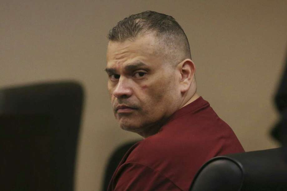 Gregorio Barrera looks around on the May 1 during his murder trial in the Bexar County 186th Criminal District Court before Judge Jefferson Moore. Barrera is accused of murdering his brother, Andres Marquez Barrera, 46, and burying his body in a shallow grave on the Padre Island National Seashore in September of 2016. Barrera faces up to life in prison. Photo: Jerry Lara /San Antonio Express-News / San Antonio Express-News