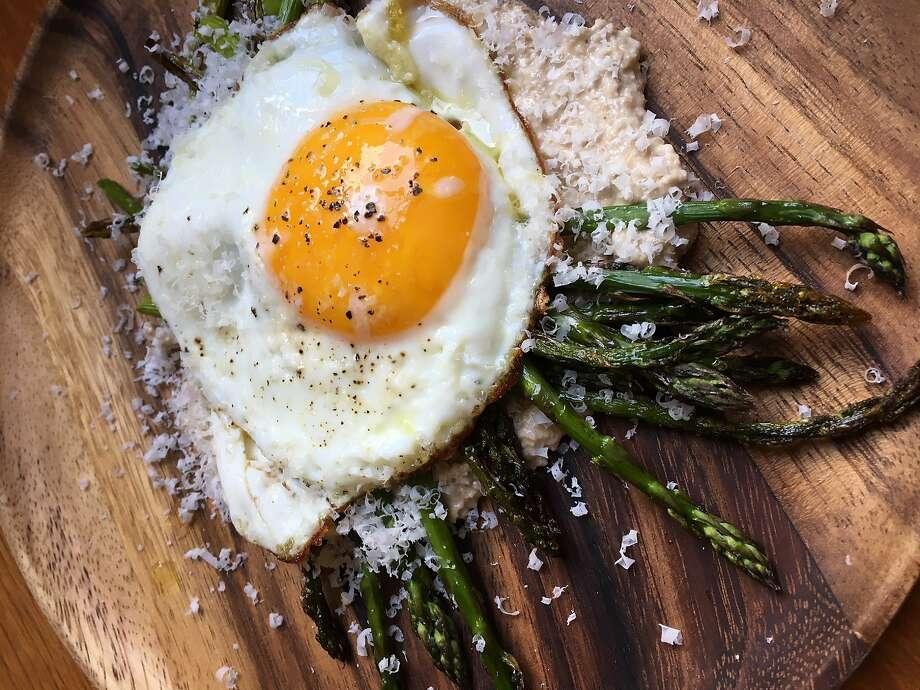 Asparagus with walnut crema and fried eggs. Photo: Jessica Battilana