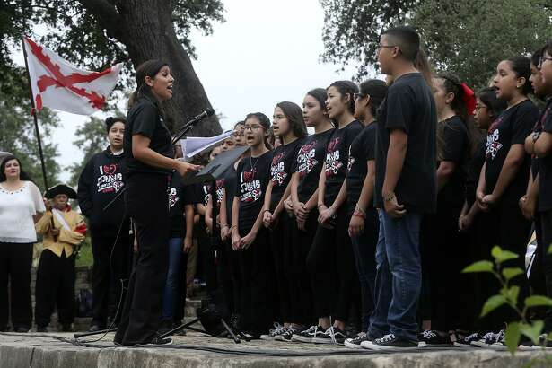 Students (facing left) from Losoya Intermediate School sing at the opening ceremonies of a Founders of Texas celebration organized by the Battle of Medina Society held Tuesday May 1, 2018 at San Pedro Springs Park. The event included a reenactment of the founding of the original Mission San Antonio de Valero exactly 300 years ago on May 1, 1718. Presentations and speeches were also made by historians, university officials and other dignitaries.