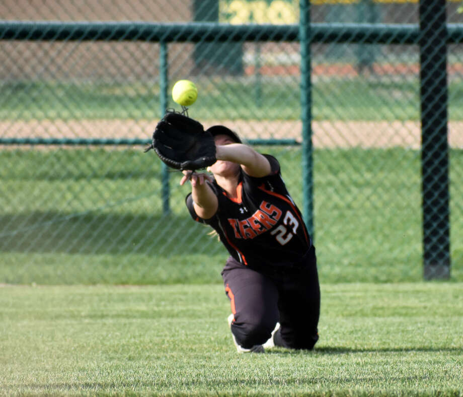 Edwardsville left fielder Lexi Gorniak makes a diving catch in the third inning against the Alton Redbirds on Tuesday in Southwestern Conference action in Edwardsville.