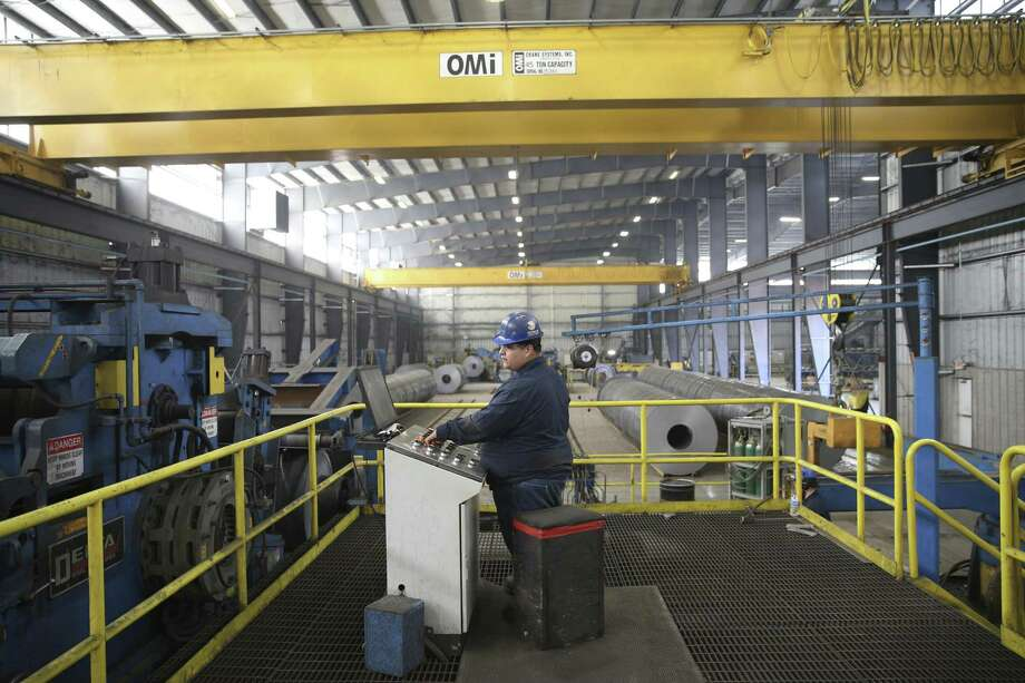 A worker operates machinery at the Borusan Mannesmann steel pipe plant in Baytown, Texas on April 23, 2018. Photo: Loren Elliott, FRE / Associated Press / AP