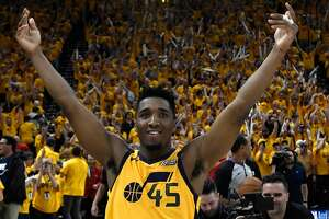 SALT LAKE CITY, UT - APRIL 27: Donovan Mitchell #45 of the Utah Jazz celebrates the Jazz win at the end of Game Six of Round One of the 2018 NBA Playoffs against the Oklahoma City Thunder at Vivint Smart Home Arena on April 27, 2018 in Salt Lake City, Utah. The Jazz beat the Thunder 96-91 to advance to the second round of the NBA Playoffs. NOTE TO USER: User expressly acknowledges and agrees that, by downloading and or using this photograph, User is consenting to the terms and conditions of the Getty Images License Agreement. (Photo by Gene Sweeney Jr./Getty Images)