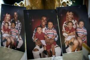 Pictures showing Stephon Clark and his wife Salena Manni, and sons Aiden Clark, 3, and Cairo Clark, 1, rested on a table inside his grandmother Sequita Thompson's home in Sacramento, Calif., on Tues., March 20, 2018. (Renee C. Byer/Sacramento Bee/TNS)