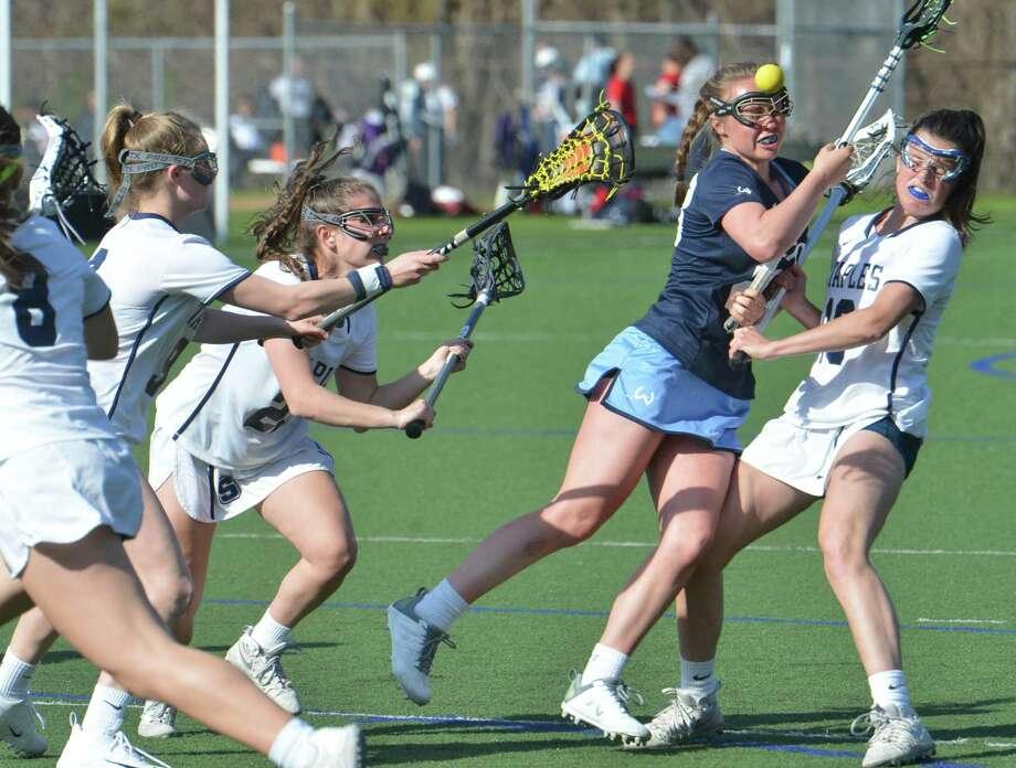Wilton's # 23 Paisley Egan brings the ball through Staples High School defenders during girls lacrosse action on Tuesday May 1, 2018 in Westport Conn. Photo: Alex Von Kleydorff / Hearst Connecticut Media / Norwalk Hour