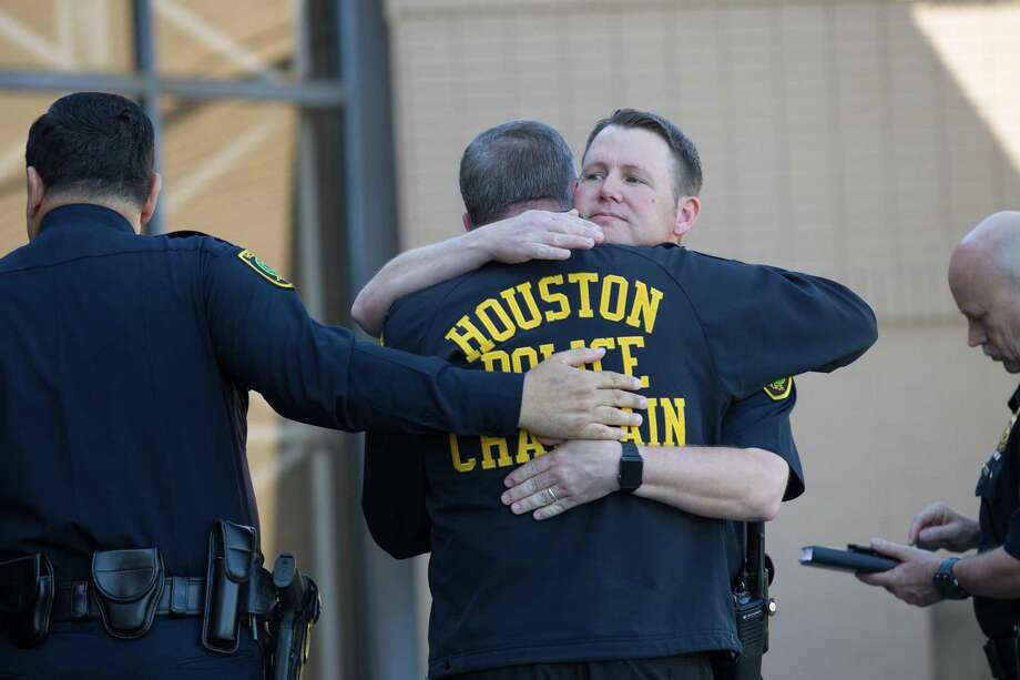 Houston Police officers embrace after chief Art Acevedo spoke with reporters about the sergeant who took his own life inside the Westside Police Station Friday, March 31, 2017 in Houston. ( Godofredo A. Vasquez / Houston Chronicle ) Photo: Godofredo A. Vasquez, PoliceSuicide / Godofredo A. Vasquez / Stratford Booster Club