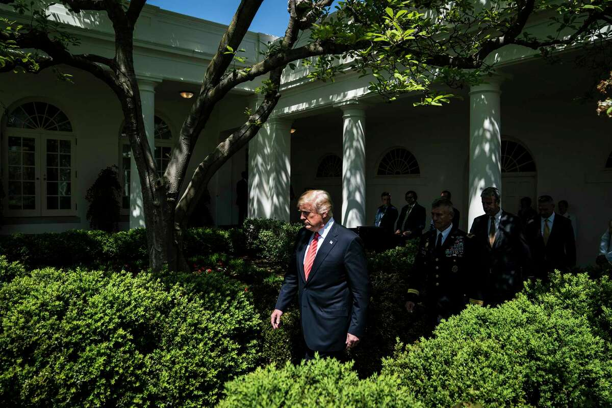 """President Trump, seen walking out to the Rose Garden at the White House on Tuesday, has repeatedly decried the investigation as a """"witch hunt."""""""
