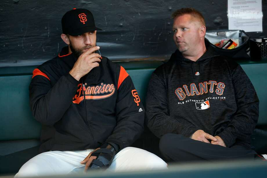 Former Giants strength and conditioning coach Carl Kochan, shown with Madison Bumgarner in April, assuredly will not the be only staffer to go in the shakeup to come. Photo: Santiago Mejia / The Chronicle