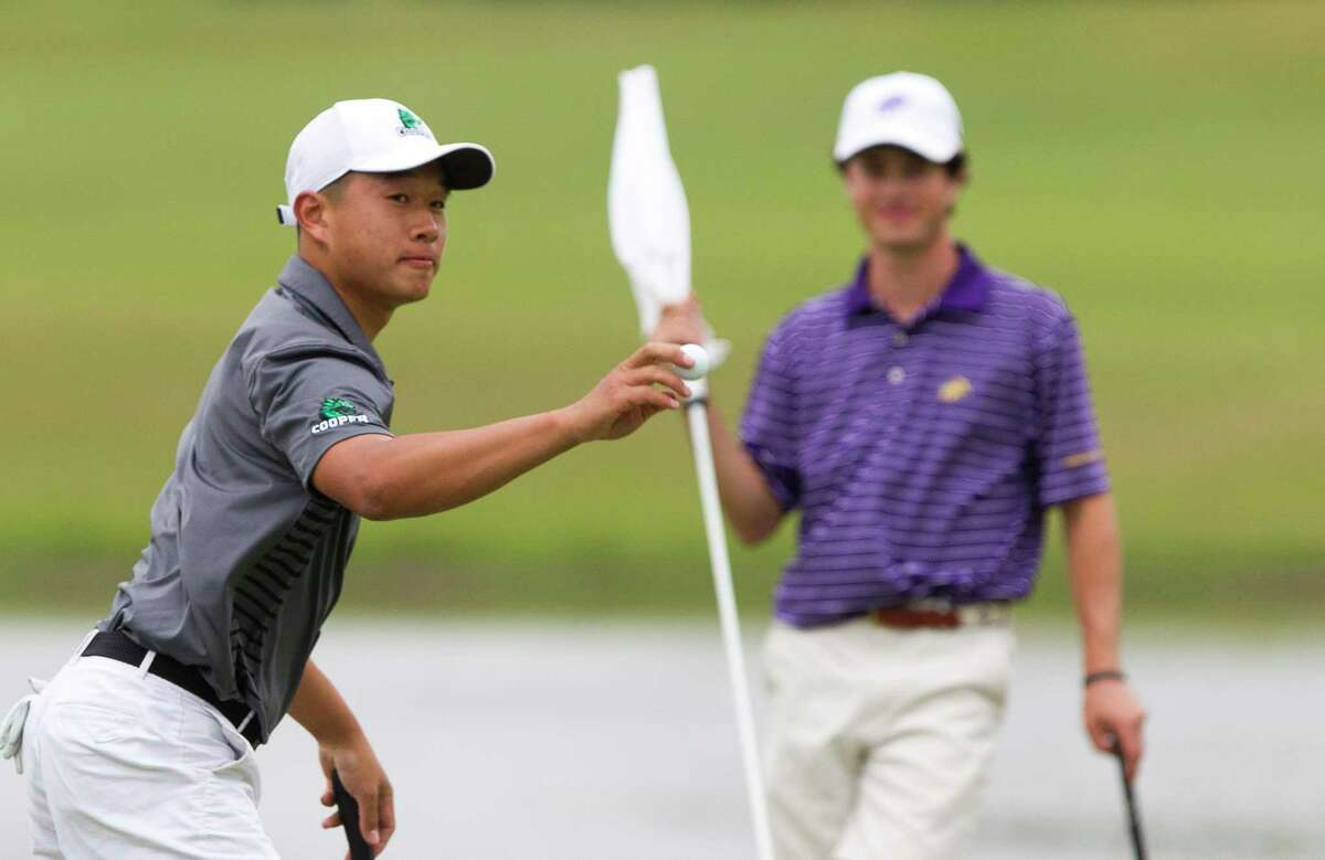 Ben Wong of John Cooper, right, acknowledges the crowd beside Cole Hammer of Kinkaid on the 18th green during the final round of the Southwest Preparatory Conference Championships at Woodforest Golf Club, Tuesday, May 1, 2018, in Montgomery.