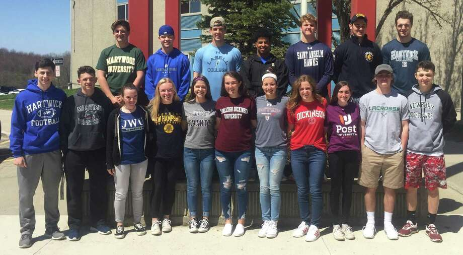 A group of New Fairfield High School senior student-athletes finalized their college plans at a signing-day ceremony at the school May 1, 2018. Pictured are (front row, from left) Nicholas Azzollini (football, Hartwick), Cristiano Ciatto (football, SUNY Maritime), Brigid McCollam (lacrosse, Johnson and Wales), Meghan Stroh (track and field, Southern New Hampshire), Shannon Broderick (field hockey, Scranton), Dana Giardina (softball, Fairleigh Dickinson), Sydney Collentine (field hockey, Eastern Connecticut), Hadley Starr (swimming, Dickinson), Melissa Evans (track and field, cross country, Post), Drew Von Werne (lacrosse, William Peace), and Vincenzo DiMaggio (baseball, Newbury); and (back row) Carson Barry (diving, Marywood), Brian Forsberg (baseball, Westfield State), Brian Consiglio (lacrosse, Lasell), Randy Benitez (football, Pace), Rit Flandreau (tennis, St. Anselm), Zach Deldin (football, Ithaca), and Chase Brindise (football, Hartwick). Photo: Richard Gregory / Richard Gregory