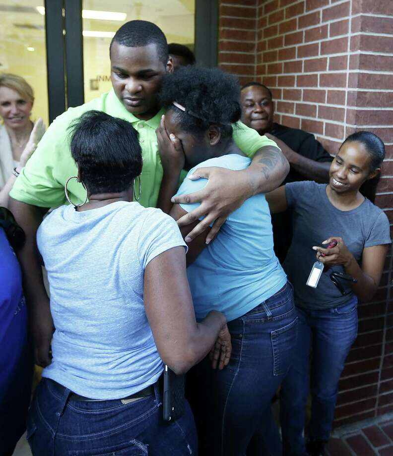 Alfred Brown walks out of the Harris County Jail and into the arms of his sister Connie Brown, left, and daughter Kierra Brown, 15, right on Monday, June 8, 2015, in Houston. Photo: Karen Warren, Staff / Houston Chronicle / © 2015 Houston Chronicle