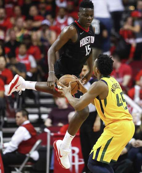 Jazz rookie Donovan Mitchell, right, has the attention of Clint Capela and the Rockets. Photo: Brett Coomer, Staff / Houston Chronicle / © 2018 Houston Chronicle