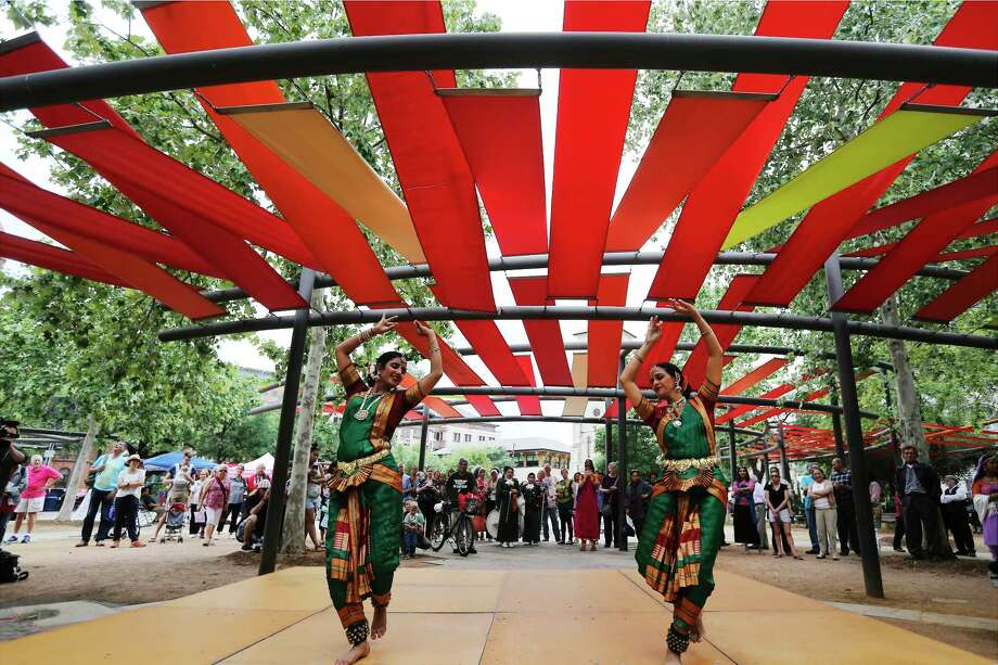 Usha Bulusu (left) and Durga Suryadevara Patel from the School Kaveri Natya Yoga perform a dance as dignitaries and the public attend the Day of Reflection event on Main Plaza with music and dance performances amongst the diverse faith community on Tuesday, May 1, 2018. A drum group from indigenous tribe representing the Native American population then played before the the special lighting of the Commemorative Flame by Mayor Ron Nirenberg. To conclude the service, a candlelight ceremony was held to commemorate the anniversary of the establishment of the original Mission San Antonio de Valero. Photo: Kin Man Hui, San Antonio Express-News / ©2018 San Antonio Express-News