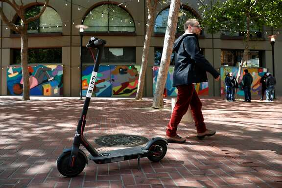 An abandoned scooter on the sidewalk in downtown San Francisco. The city has required scooter companies to stop operations as of June 4 while it works out a permitting process.