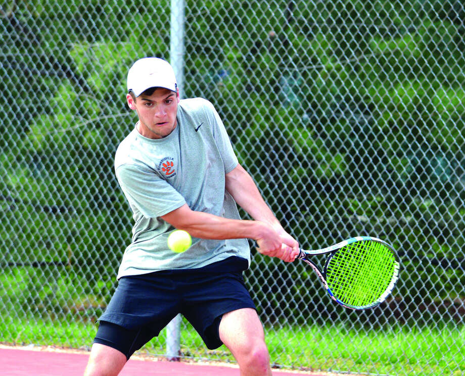 Edwardsville junior Seth Lipe makes a backhand return during his No. 3 singles match against O'Fallon on Tuesday at the EHS Tennis Center.