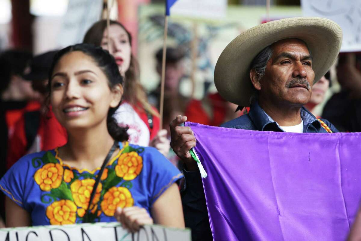 Hundreds, including Jose Huerta, right, take part in the 19th annual May Day March for Immigrant and Workers Rights in Seattle, Tuesday, May 1, 2018. Demonstrators marched from Judkins Park to downtown.