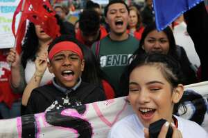 Kids from Southwest Youth and Family Services chant together as hundreds take part in the 19th annual May Day March for Immigrant and Workers Rights in Seattle, Tuesday, May 1, 2018.  Demonstrators marched from Judkins Park to downtown.