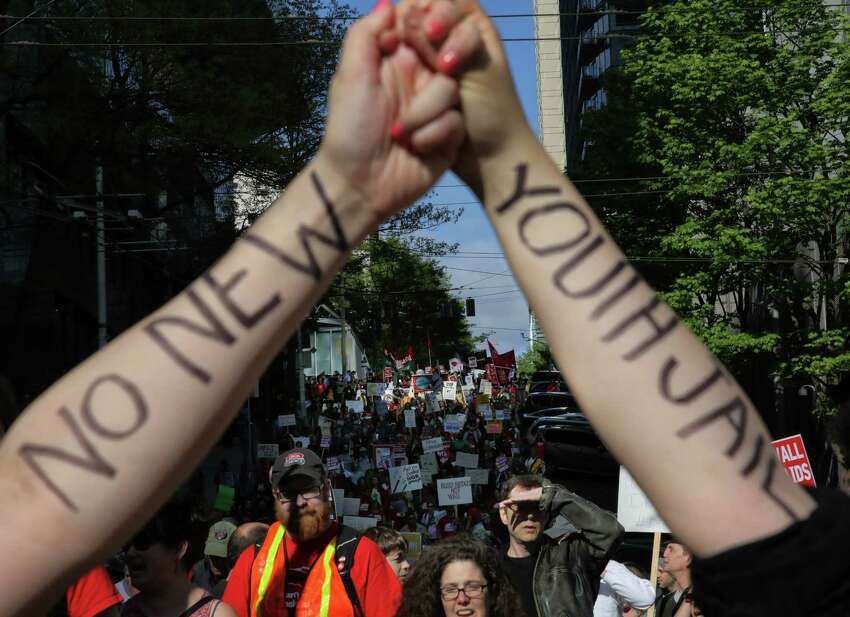 Hundreds take part in the 19th annual May Day March for Immigrant and Workers Rights in Seattle, Tuesday, May 1, 2018. Demonstrators marched from Judkins Park to downtown.