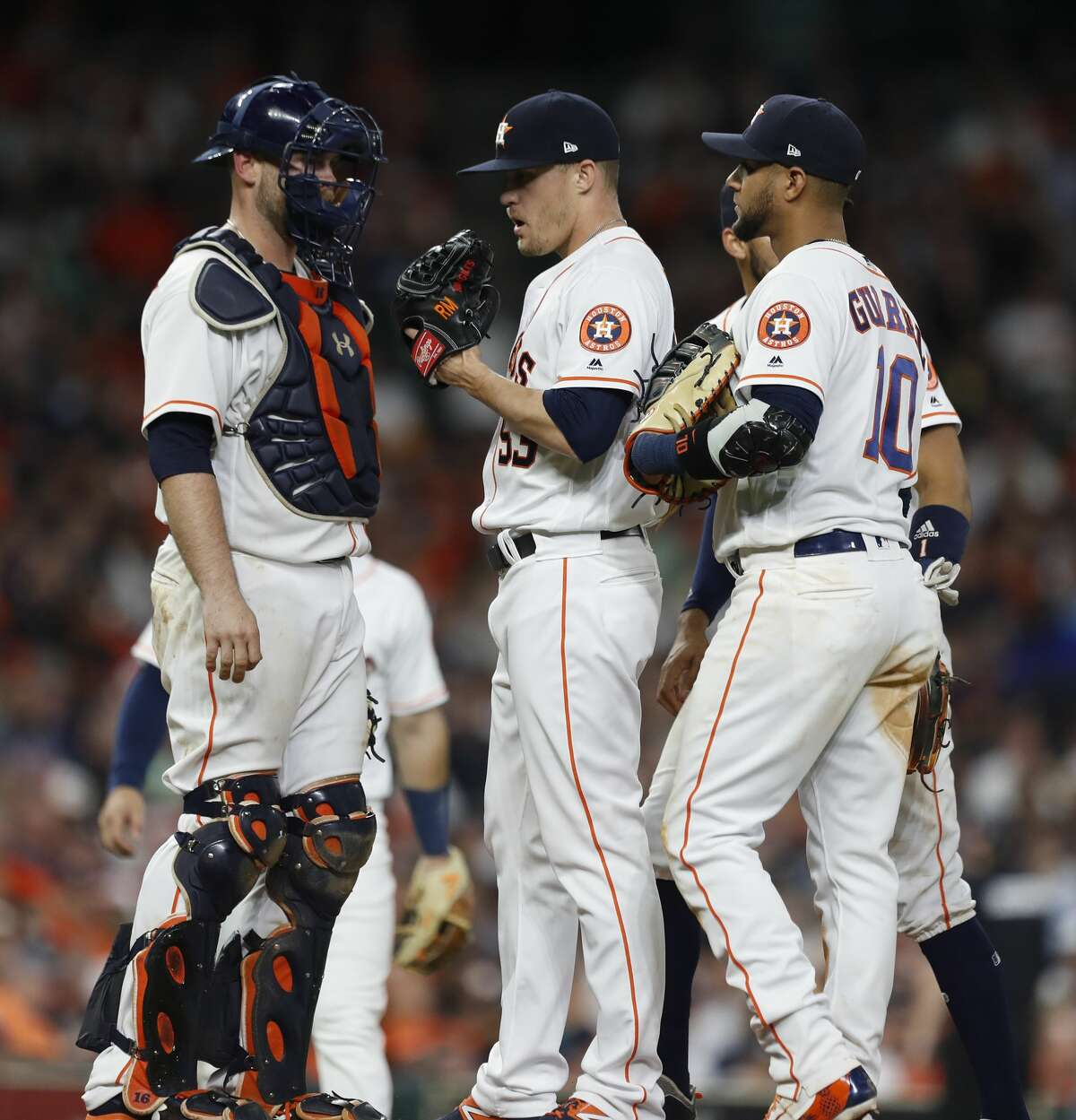 Houston Astros relief pitcher Ken Giles (53) gets a visit to the mound by catcher Brian McCann (16) during the ninth inning of an MLB game at Minute Maid Park, Tuesday, May 1, 2018, in Houston. ( Karen Warren / Houston Chronicle )