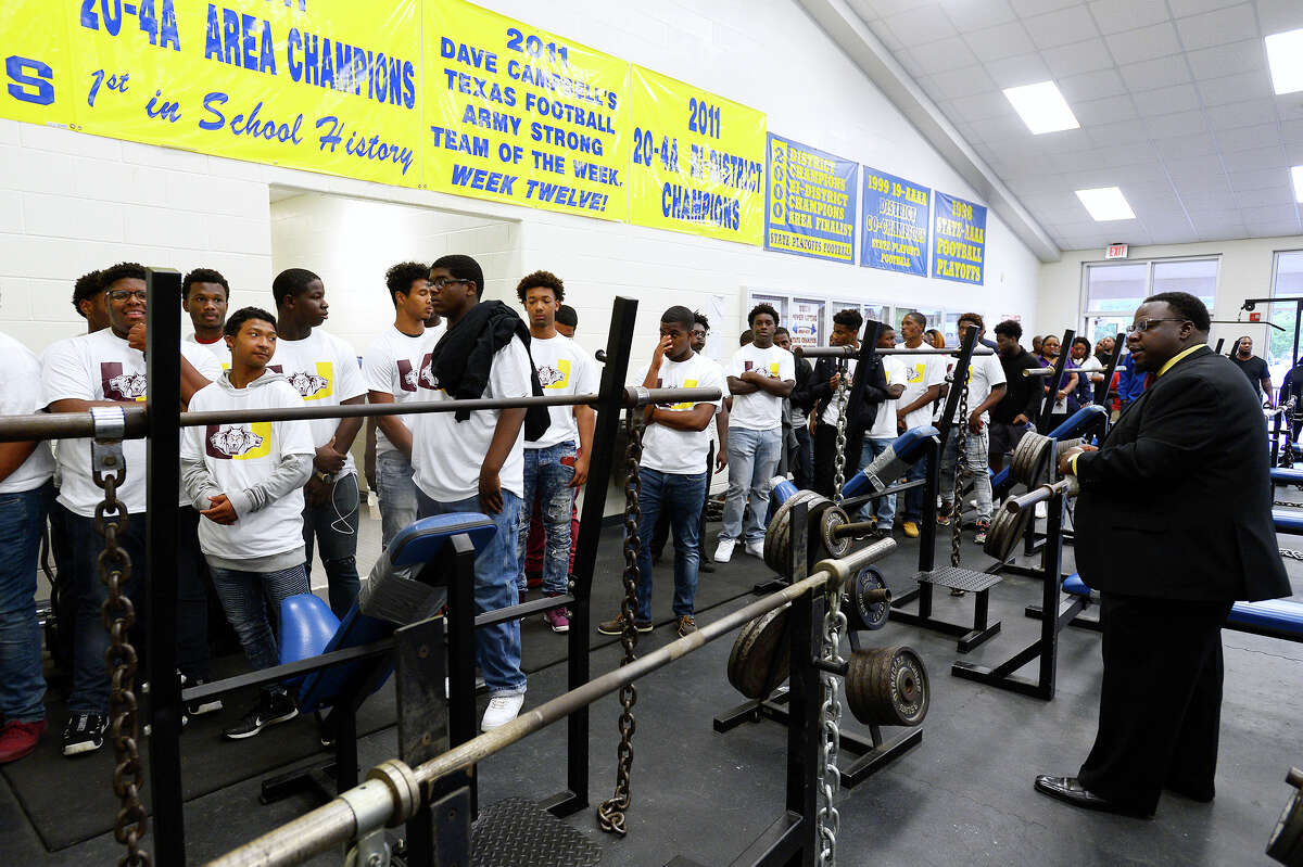 Beaumont United assistant coach Ed Taylor leads players on a tour of the weight room during the football team's orientation night at Ozen High School. The event offered parents and incoming players an opportunity to tour the facilities and meet the coaches. Photo taken Tuesday 5/1/18 Ryan Pelham/The Enterprise