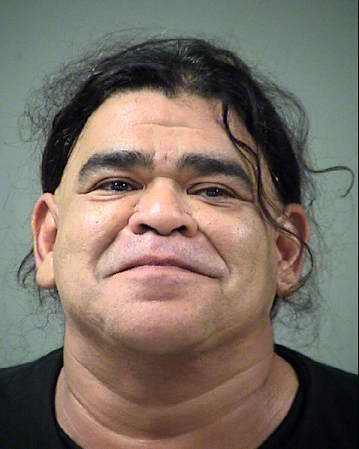 Manuel Romo, 49, charged with hindering apprehension, a third-degree felony,