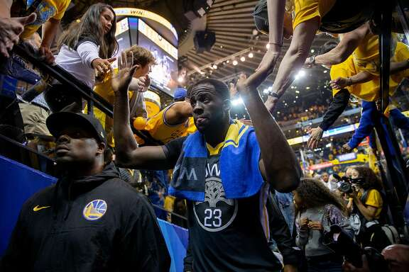 Golden State Warriors forward Draymond Green (23) greets fans as he exits to the locker room following the end of the fourth quarter of Game 2 of the NBA Western Conference semifinals between the Golden State Warriors and New Orleans Pelicans at Oracle Arena, Tuesday, May 1, 2018, in Oakland, Calif. The Warriors won 121-116.