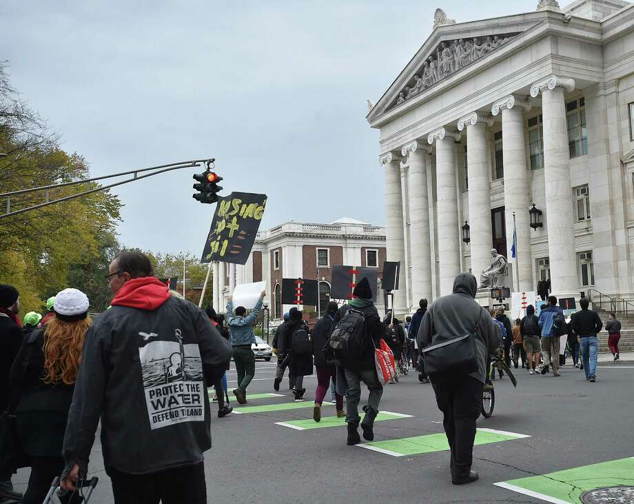 Images of a march seeking an end to discrimination against the homeless sponsored by the Connecticut Bail Fund in downtown New Haven, Nov. 1, 2017. Photo: Catherine Avalone / Hearst Connecticut Media / New Haven Register