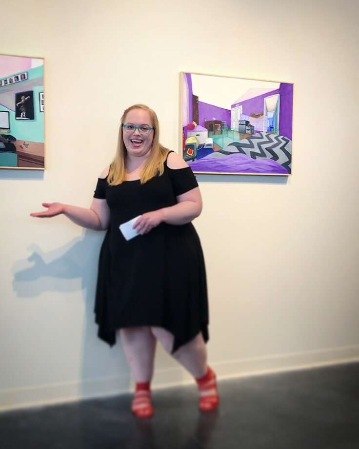 Maddie Aunger with some of her art pieces that are on display at the Edwardsville Arts Center.