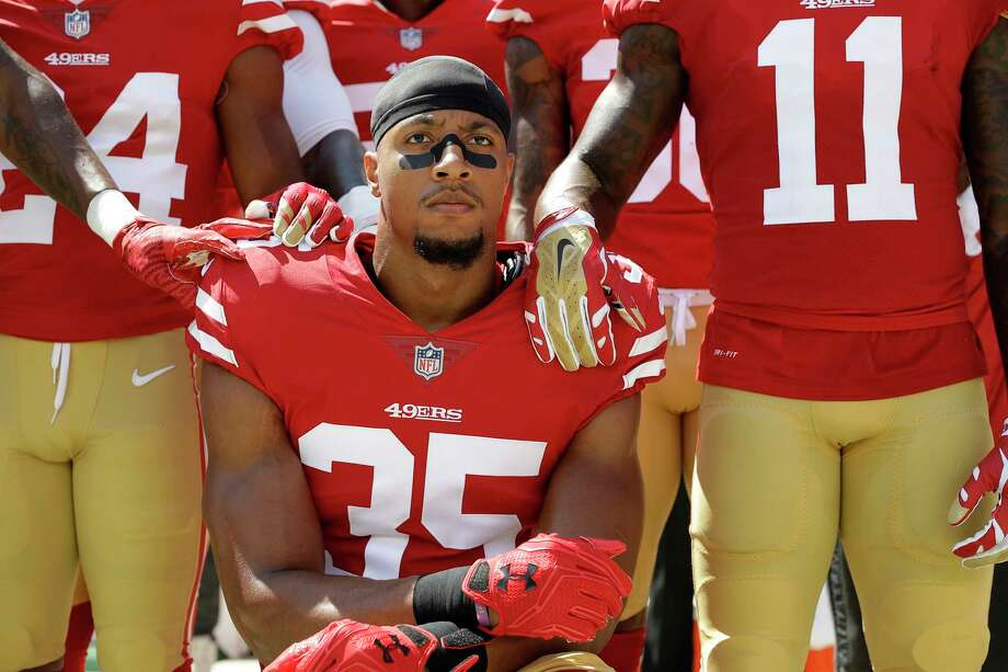 San Francisco 49ers safety Eric Reid (35) kneels in front of teammates during the playing of the national anthem before an NFL football game between the 49ers and the Carolina Panthers in Santa Clara, Calif., Sunday, Sept. 10, 2017. Photo: Marcio Jose Sanchez, AP / ONLINE_YES