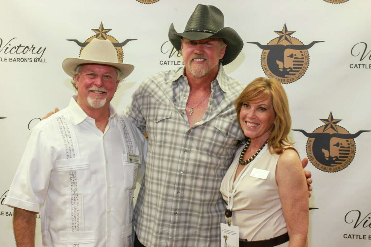 Trace Adkins, center, with Russell and Gigi Harbison at the Cattle Baron's Ball.
