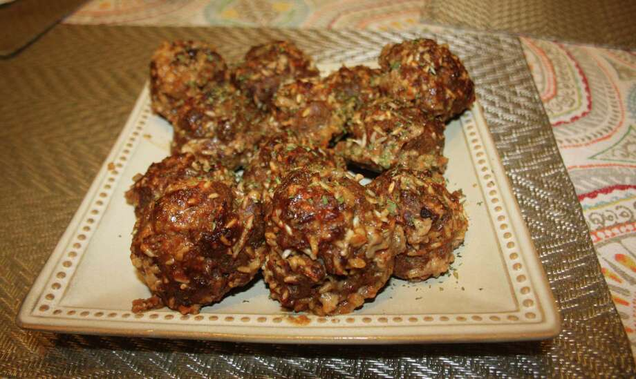 The finished porcupine meatballs, which incorporate a can of tomato soup, ground beef, long-grain rice and an assortment of spices. Photo: Chuck Blount /San Antonio Express-News