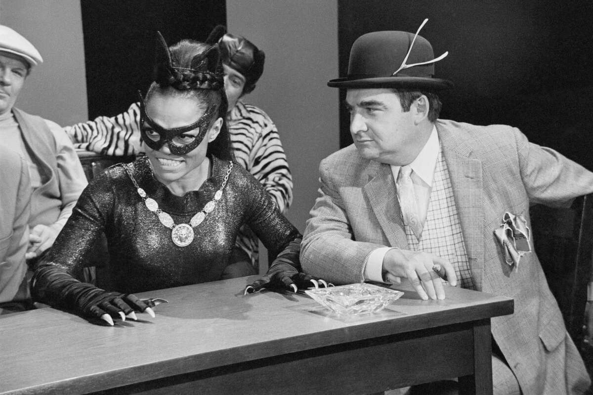 """Former Senator and Press Secretary Pierre Salinger in his role as crooked lawyer """"Lucky Pierre"""" (with client """"Catwoman"""", played by Eartha Kitt), on the campy 1960s TV series """"Batman""""."""
