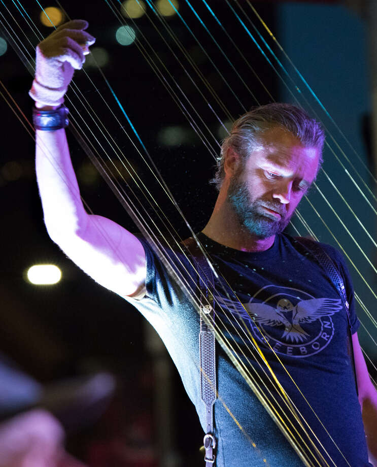 William Close plays the Earth Harp. (Provided photo.)