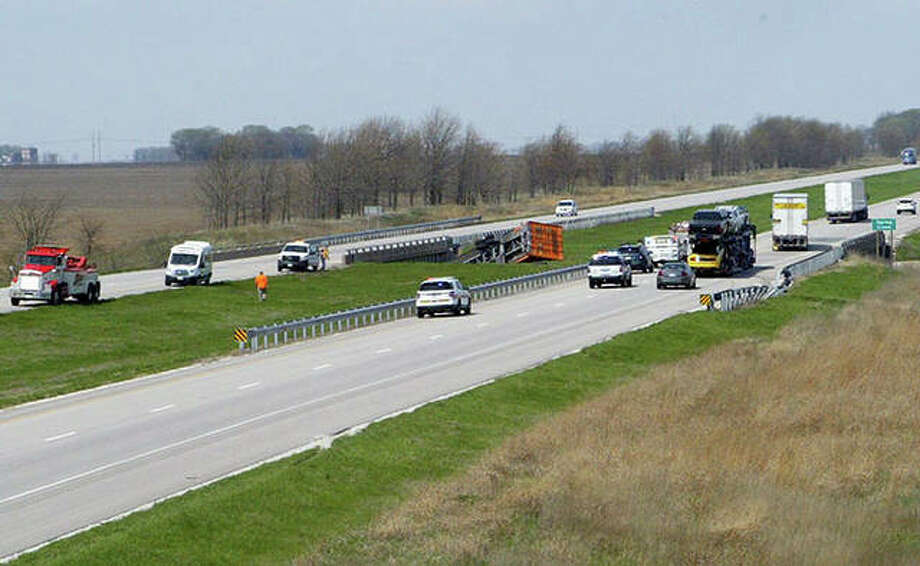 Emergency crews respond to an accident on Interstate 72 in which a semitrailer truck ended up in a ravine.
