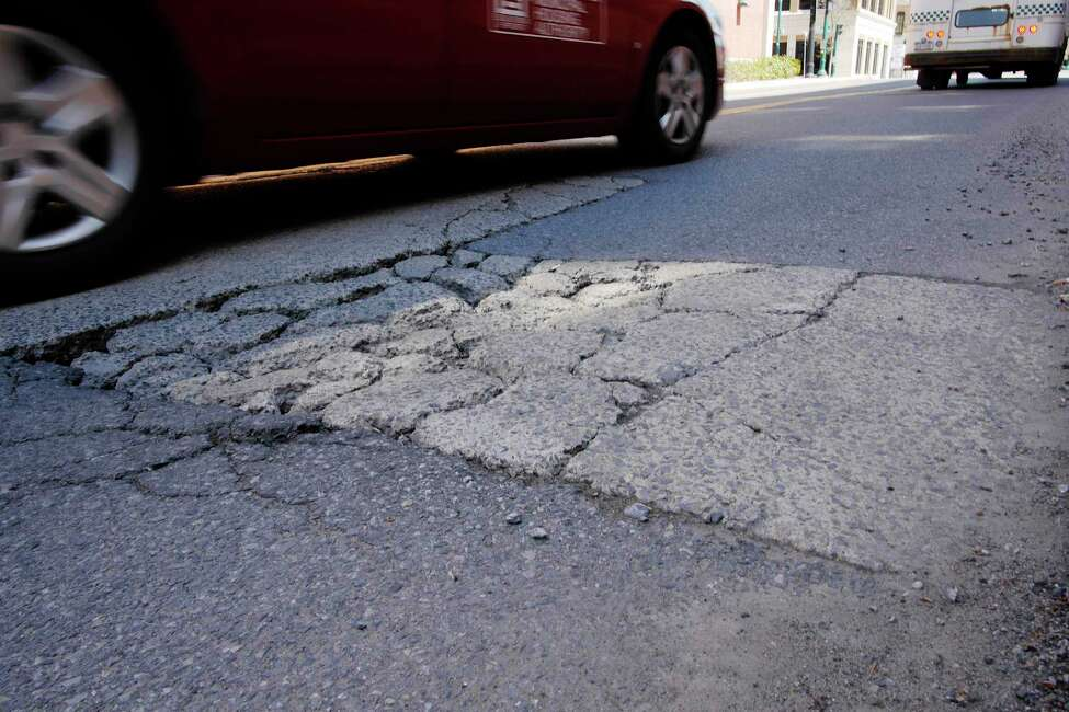 A view of a pothole on Clinton Street on Wednesday, May 2, 2018, in Schenectady, N.Y. (Paul Buckowski/Times Union)