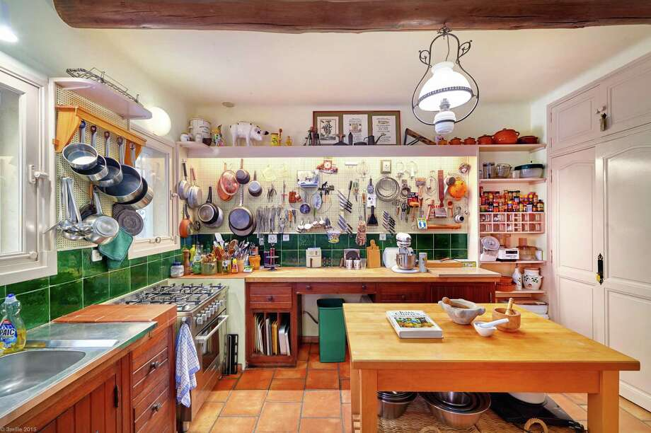 In Provence, France, La Pitchoune's cottage accommodates just six guests, the perfect amount for Julia Child's small kitchen, a replica of the kitchen from her Cambridge, Mass. home. Photo: Sotheby's / Sotheby's