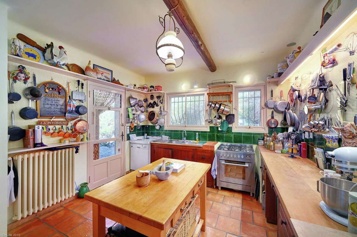 Pegboard walls in the kitchen have been traced with outlines of pots, pans, peelers and other kitchen gadgets, including some of Child's originals utensils.
