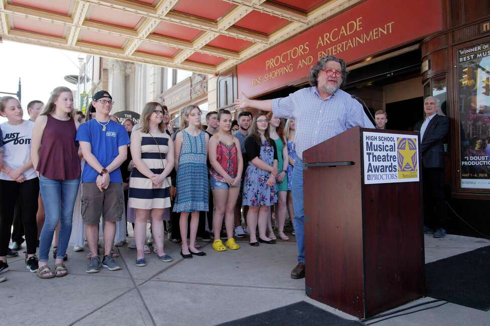 Proctors CEO Philip Morris, at podium, along with area high school students who have taken part in a play, gather for the High School Musical Theatre Award nominations outside Proctors on Wednesday, May 2, 2018, in Schenectady, N.Y. (Paul Buckowski/Times Union)