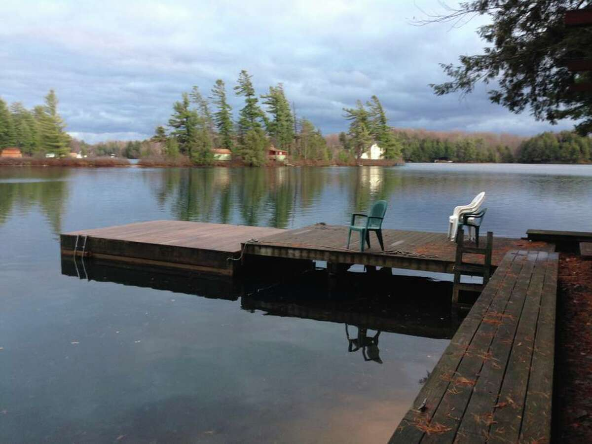 """Star Lake, NY. Stone House: A Lakefront Respite. Price: $220. """"A quiet, sweet house right on Star Lake, the gem of the Adirondacks. Private dock and stone patio, fireplace, full amenities, 3 bedrooms, 2 full baths. Did we say lakefront already? Ten feet away from the front door."""" View full listing on Airbnb."""