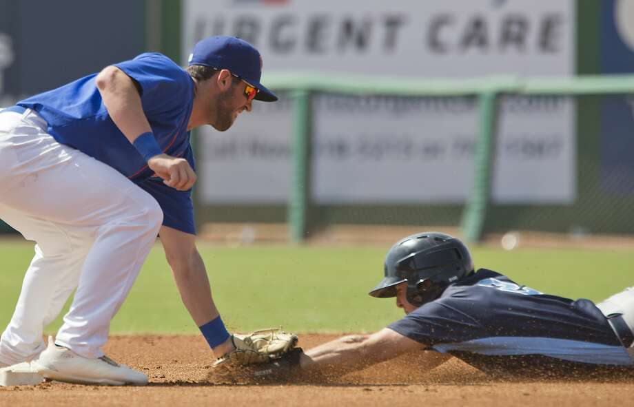 RockHounds' Mikey White puts the tag on Corpus Christi Hooks' Miles Straw as he tries to steal second 05/02/18 at Security Bank Ballpark. Tim Fischer/Reporter-Telegram Photo: Tim Fischer/Midland Reporter-Telegram